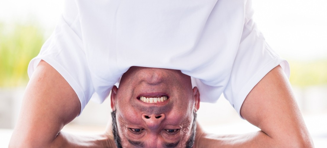 bigstock-Happy-man-headstanding-while-d-46396303